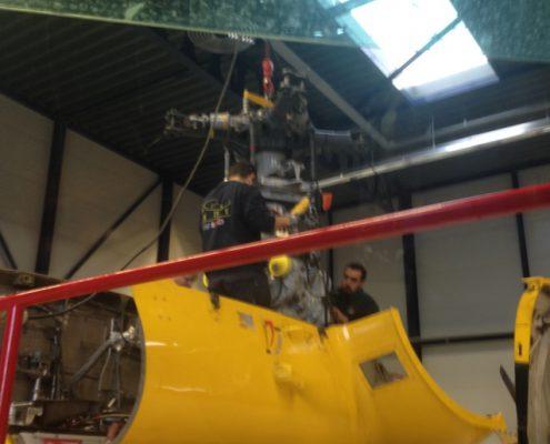 hijswerk-muntjewerfgraafmachines-helicopter